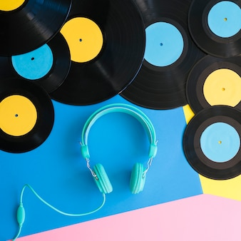 Retro music concept with turquoise headphones