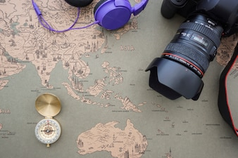 Retro world map background with compass and camera