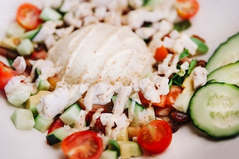 Rice dish with tomatoes and cucumber