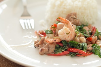 Rice topped with stir-fried shrimp and basil