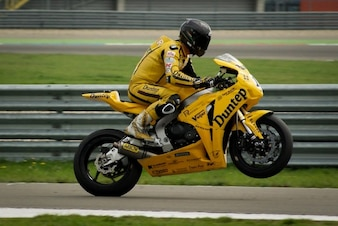Rider performing wheelie