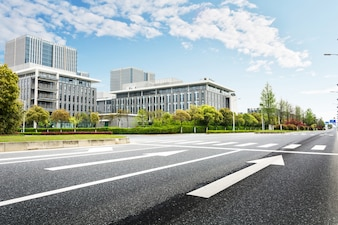 Road with buildings background