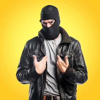 Robber doing surprise gesture on colorful background