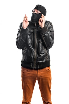 Robber with his fingers crossing