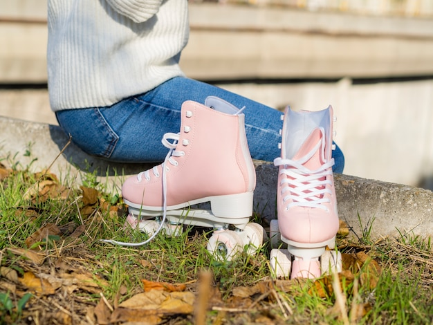 Roller skates on grass and leaves