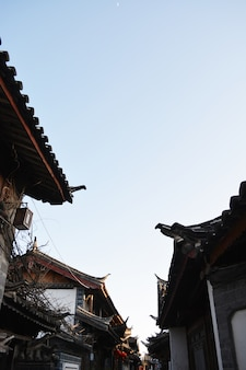Roofs of houses with sky background