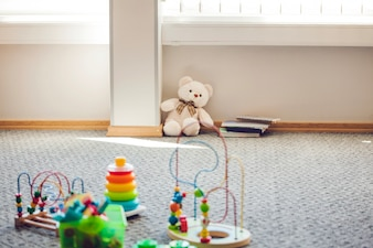 Room with children toys placed on rug