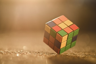 Rubik's cube located on the colored background,