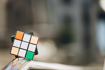 Rubik's cube on blurred background