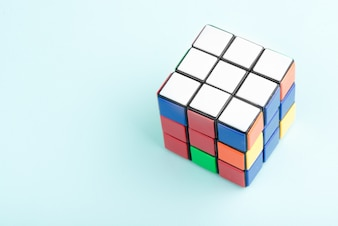 Rubik's cube on the light blue background