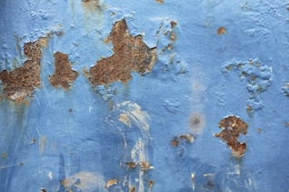 Rust metal in a blue wall texture