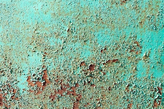 Rust on a green metal sheet, rusty background, rusty metal fence