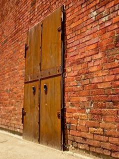 rusted iron door  brick