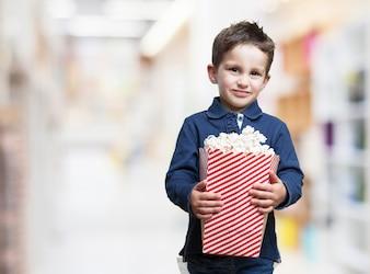 Sad boy with a bucket of popcorn