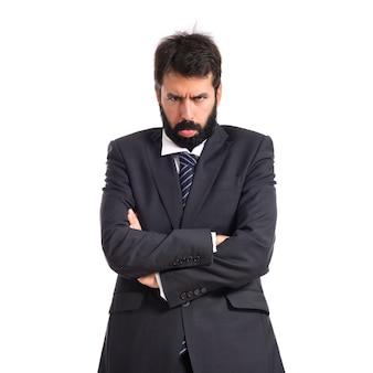 白い背景の悲しいビジネスマン