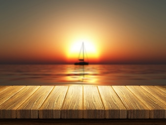 Sailing boat in the middle of the sun at sunset