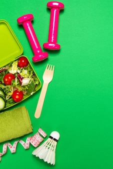 Salad with weights and a badminton ball
