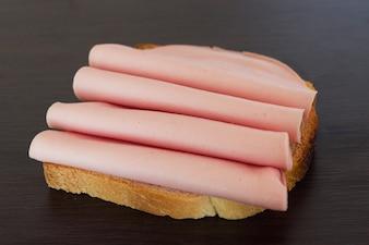 Salami sandwich. Open sandwich of salami slices on bread.