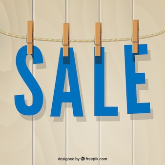 sale, papel letters hanging with clothespins