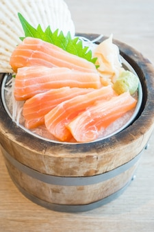 Salmon fillets on wooden container
