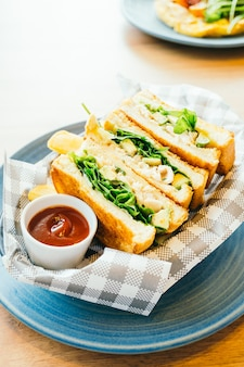 Sandwich with avocado and chicken meat with french fries