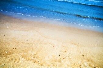 Sandy beach with sea background