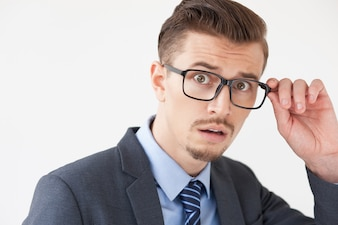 Scared Young Business Man Adjusting Glasses