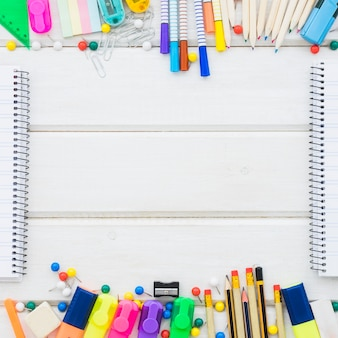 School decoration frame concept with notebooks and space