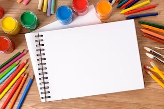 School desk with art notebook