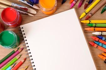 School notebook with art equipment