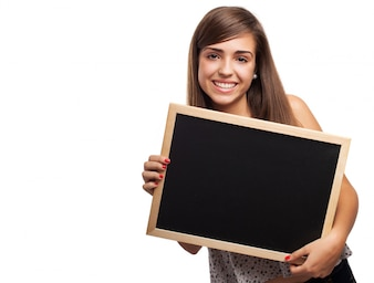 Schoolgirl having fun with an empty slate