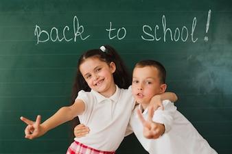 Schoolmates at blackboard together