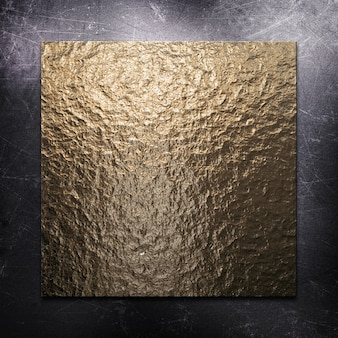 Scratched metallic background with gold metal plate