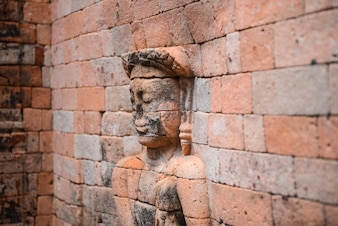 Sculpture of a person in bricks