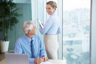Senior Boss and Female Assistant Talking in Office