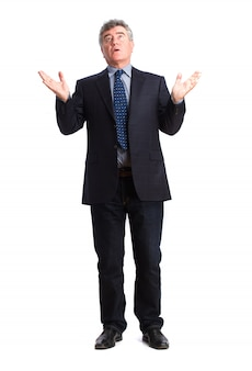 Senior businessman looking up with open hands
