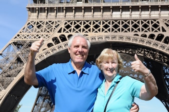 Senior couple in front of eiffel tower in paris