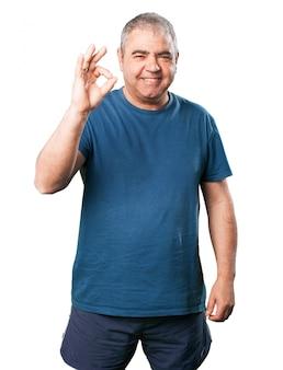 Senior man saying  ok  with his hand