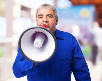 Senior man speaking through a megaphone