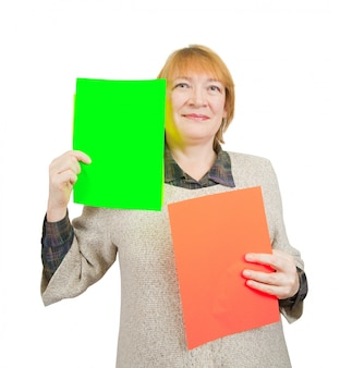 Senior woman holding empty red and green posters.