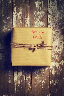 Sentence  for my love  with a stamp on a brown gift