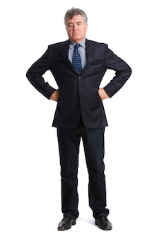 Serious businessman with hands on waist