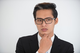 Serious face of young businessman pondering