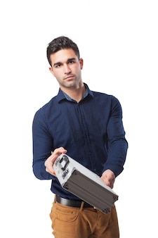 Serious man holding a metal briefcase