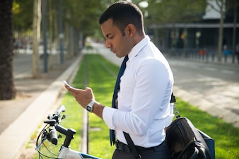 Serious Office Worker Reading Message on Phone