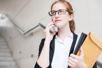 Serious Student Calling on Phone on Staircase