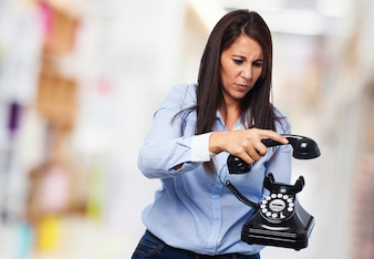 Serious woman hanging a phone