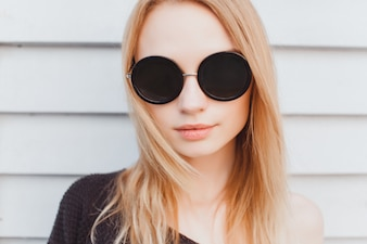 Serious woman with big sunglasses