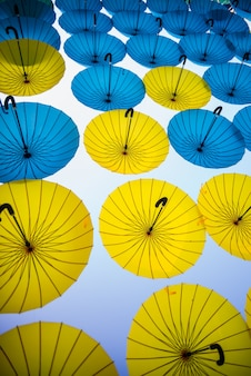 Set of colored umbrellas in the air