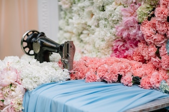 Sewing machine with fabric and flowers